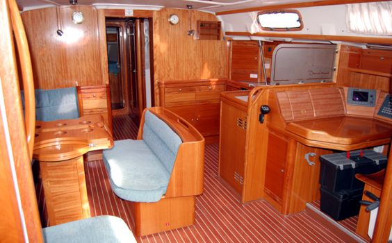 The Bavaria 50 Cruiser main cabin. Outside the cockpit has teak lazerette ...