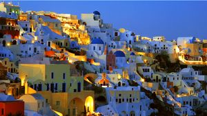 A typical Chora on a Cyclades island as the afternoon sun sets and the evening lights come on