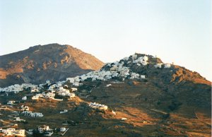Chora on the island of Serifos in the Cyclades island as the sun sets and the evening lights come on