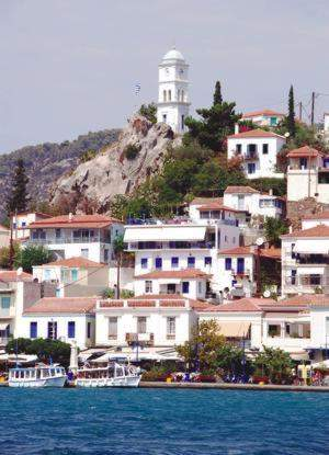 The famous clock tower above the town of Poros and home of Greek Sails