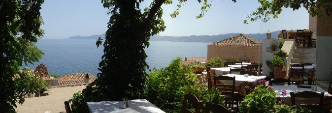 Eating out during your sailing holiday both gives you the local flavour of Greece and can provide you some stunning views of your surroundings. This view of in Monemvasia, looking south towards Cape Maleas