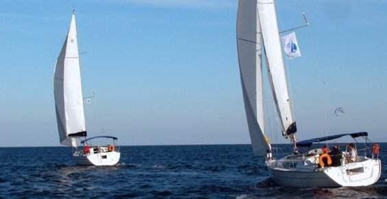 A Greek Sails Jeanneau Sun Odyssey 32i and 35 sail away during a flotilla sailing holiday