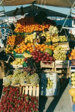 A typical fruit caique in Aegina selling fruit directly from the boat