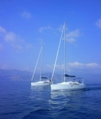Two Greek Sails Jeanneau 36i yachts sailing together during a flotilla holiday
