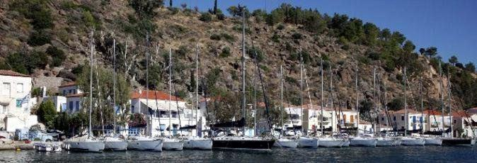 Greek Sails flotilla & bareboat charter yachts along the quay at their Poros yacht base
