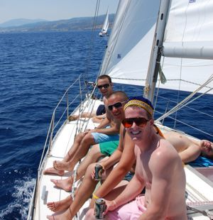 A crew endure the hard life of cabin charter yacht cruising with Greek Sails