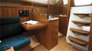 The main saloon and companionway of a Sun Odyssey 32 sailing yacht