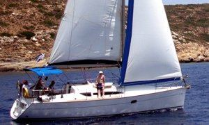A Greek Sails Sun Odyssey 32 sailing yacht underway during a flotilla sailing holiday