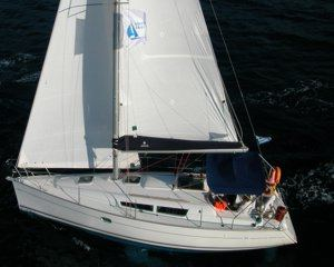 A Greek Sails Jeanneau Sun Odyssey 32i sailing yacht underway during a flotilla sailing holiday