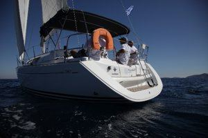 A Greek Sails Sun Odyssey 36i sailing yacht making way during a flotilla sailing holiday from Poros, Greece