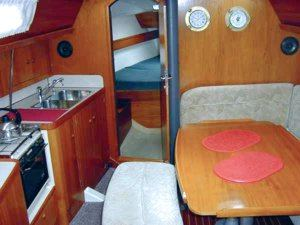 The main saloon of a Sun Odyssey 37.1 sailing yacht. Image courtesey & with permission of Chantiers Jeanneau S.A.