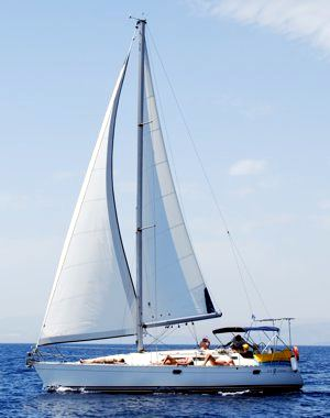 A Greek Sails Sun Odyssey 37.1 sailing yacht underway during a flotilla sailing holiday from Poros, Greece