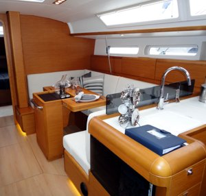 The Sun Odyssey 409 has a light, spacious & bright main saloon with good seating and an adaptable table that can be lowered to make an additional double berth, or 'folded over' to extend out across the entire cabin width and seat more people