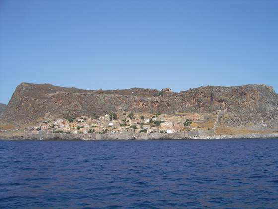 Sailing holiday locations in Greece: Looking north west at the medieval walled town of Monemvasia built below the earlier Byzantine town and fortress above