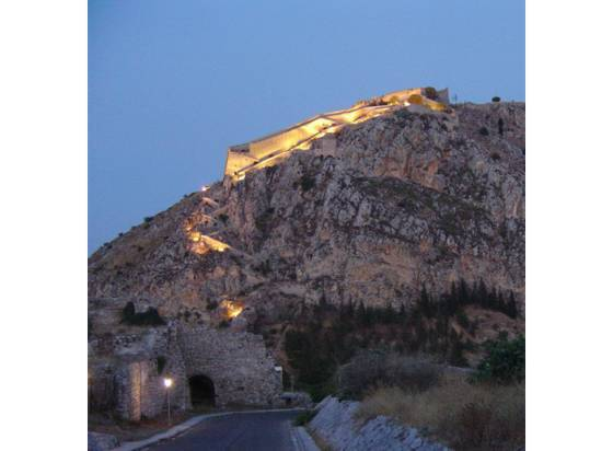 Sailing holiday locations in Greece: Looking up from the twon at the old walled town; the Akronavplia