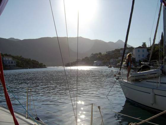 Sailing holiday locations in Greece: Looking up the 'fjord' at Yérakas with the village to the right and the salt water lagoon beyond through the narrows