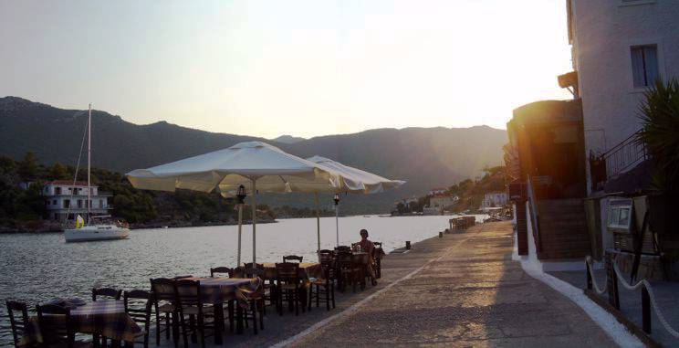 Sailing holiday locations in Greece: Relaxing on the quayside, Yérakas, as the sun sets behond the Pelopopnnese mainland