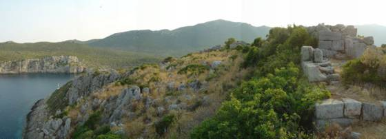 Sailing holiday locations in Greece: Parts of the ruined Mycenean acropolis on ák Kástro (Castle Cape)