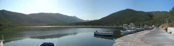Sailing holiday locations in Greece: Looking across the salt water lagoon at the head of the 'fjord'