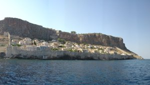 The medieval town of Monemvasia hugs the rock, Monemvasis, Peloponnese, Greece