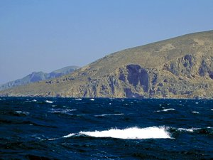 Sailing the Cyclades islands in the Aegean with the Meltemi wind blowing