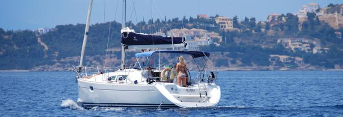 A Greek Sails Sun Odyssey 36i yacht on flotilla makes its way into the Spetses channel heading north west towards the Argolic Gulf