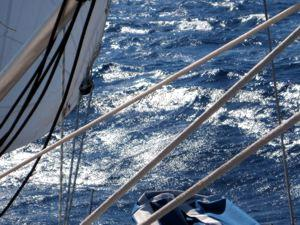 The sun glistens off the surface of the crystal clear Aegean during a Greek Sails flotilla sailing holiday
