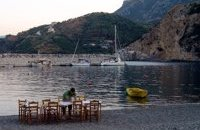 Real waterside eating in Sabatiki as tables are laid out on the beach at the end of the day
