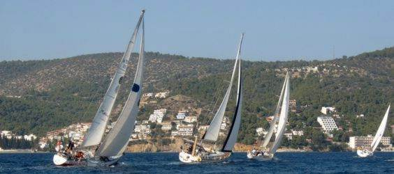 Yachts race 'round the cans' on the first day of the 2008 Greek Sails Round the Island race, Poros, Greece